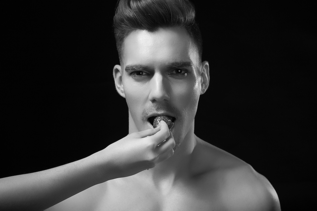 Hand, strawberries, portraiture, male model, french model.